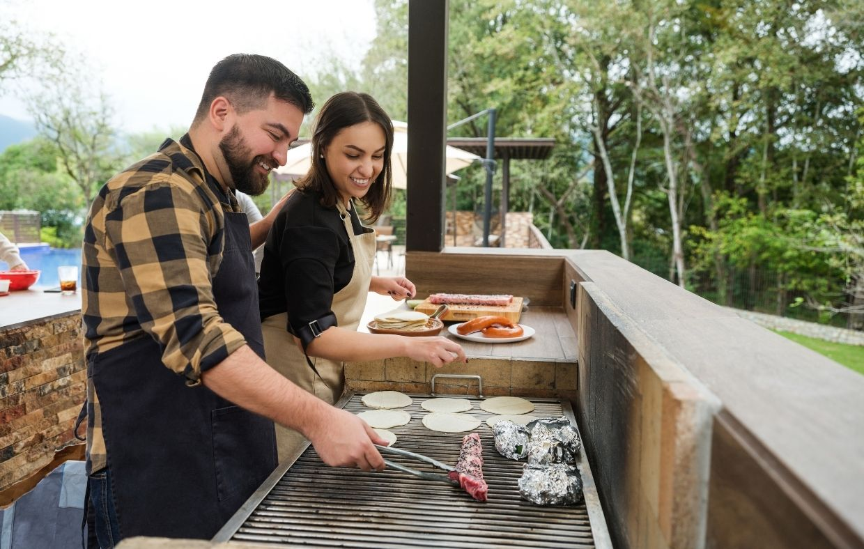 grilling in outdoor kitchen